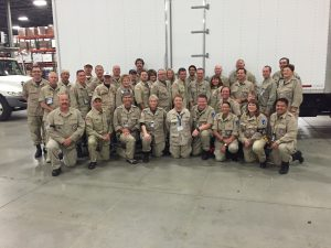 members of the utah disaster medical assistance team pose for a group photo in their uniforms