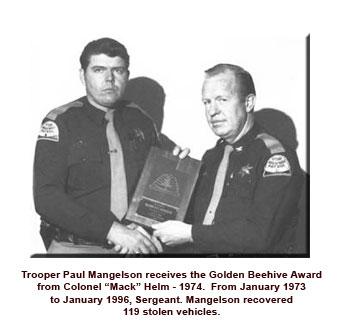 Trooper receiving golden Beehive award