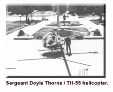 Sgt. Thorne with TH-55 helo