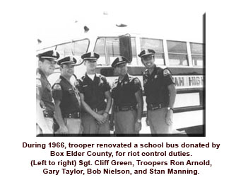 Riot squad troopers next to a school bus