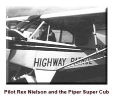 Pilot Rex Nielson and Piper Cub air patrol