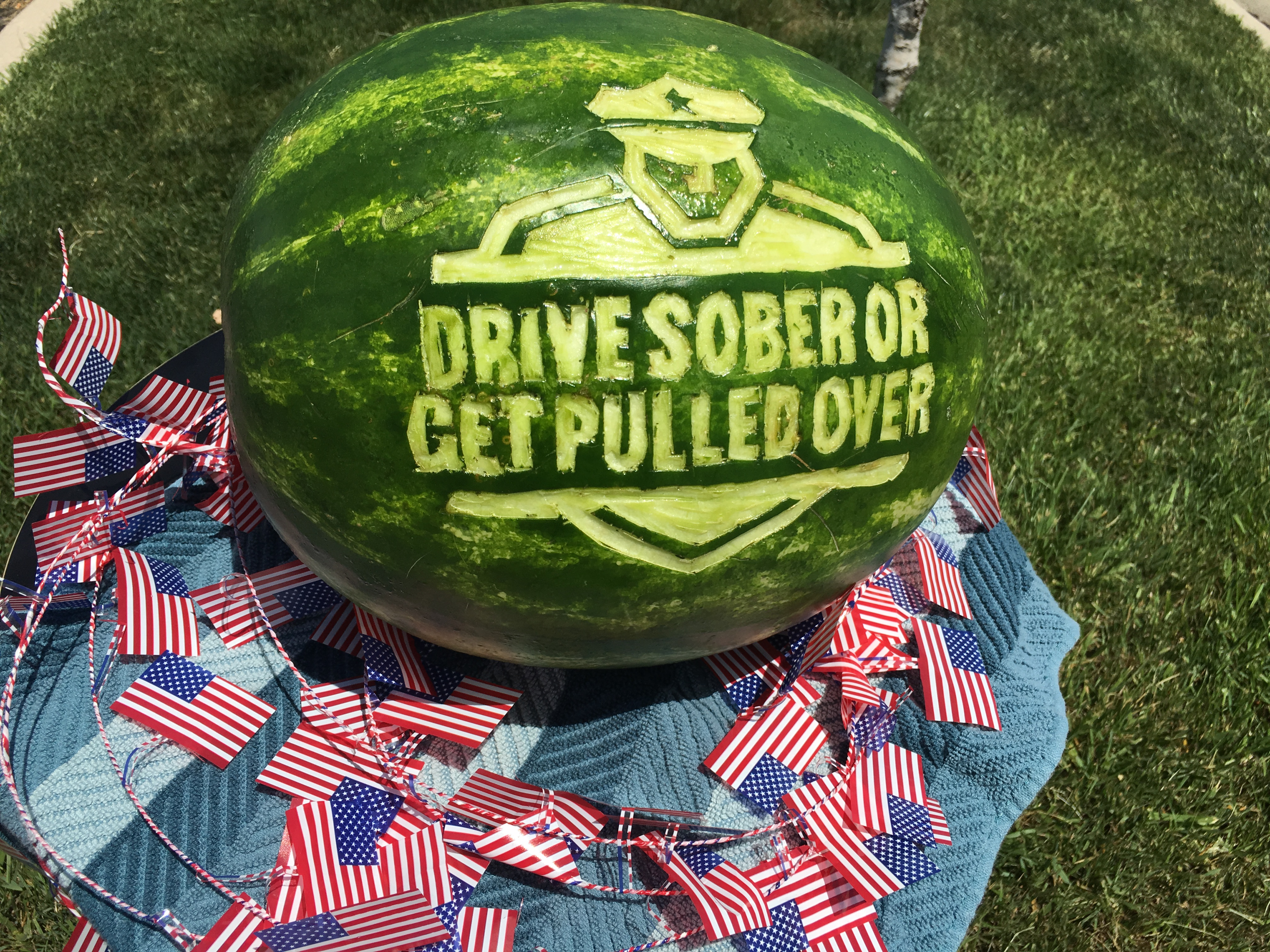 watermelon with the Drive Sober or Get Pulled Over logo carved into it