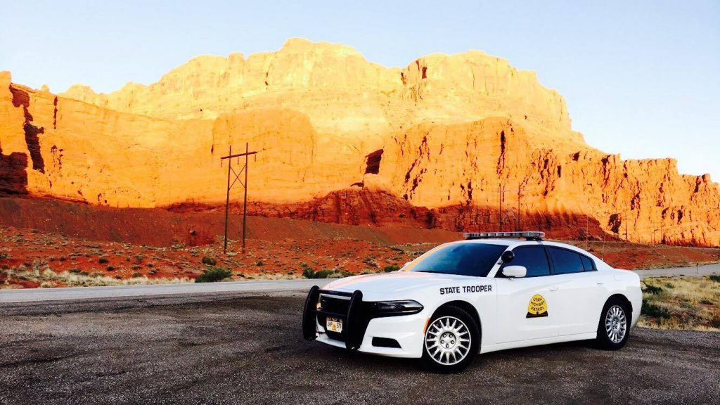 A UHP Charger across from red rock outside of Moab