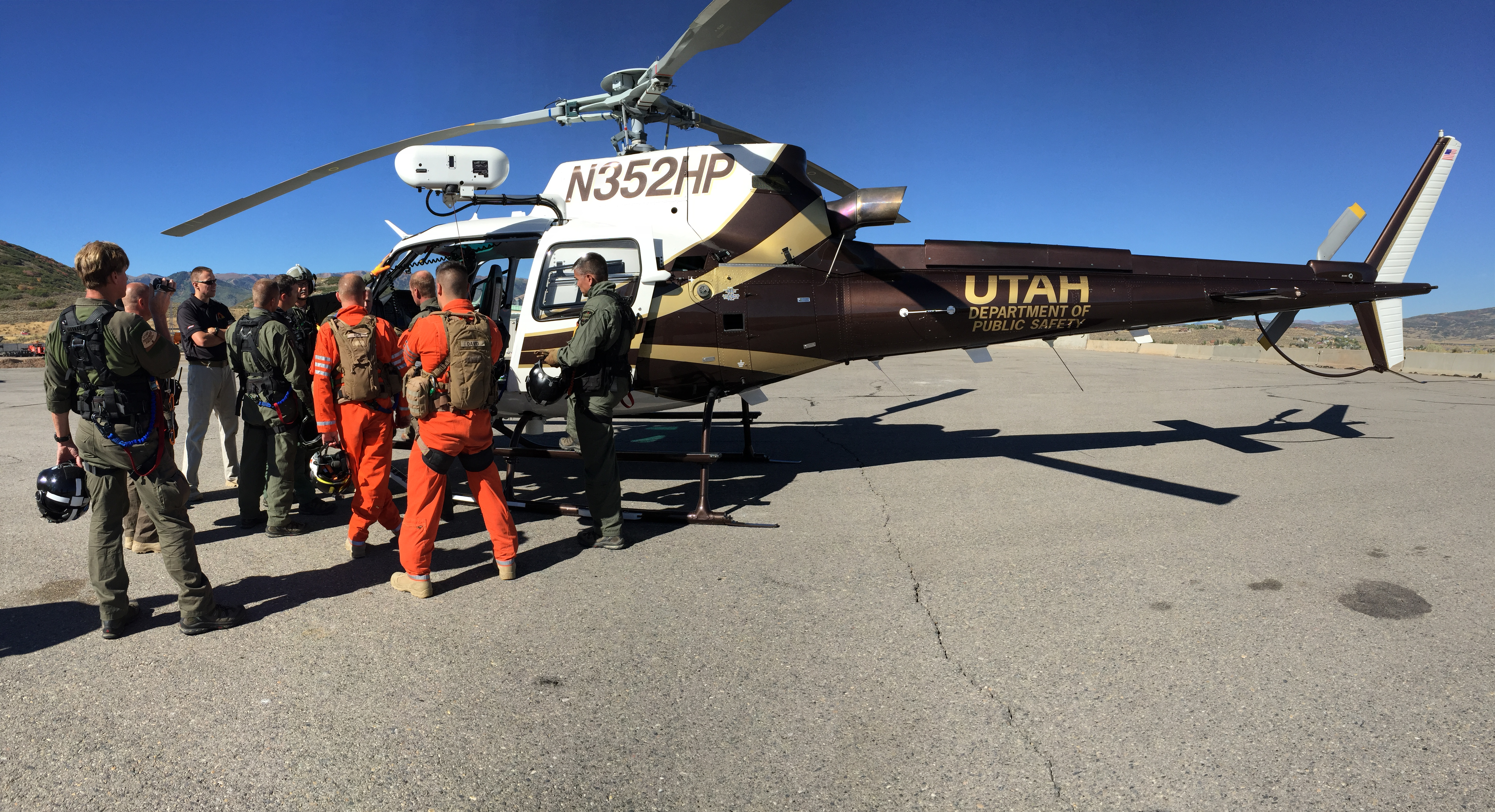 Pilots and tactical flight officers participate in hoist training with the DPS helicopter