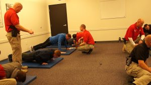 Candidates for UHP perform push ups