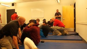 Candidates for UHP perform sit ups