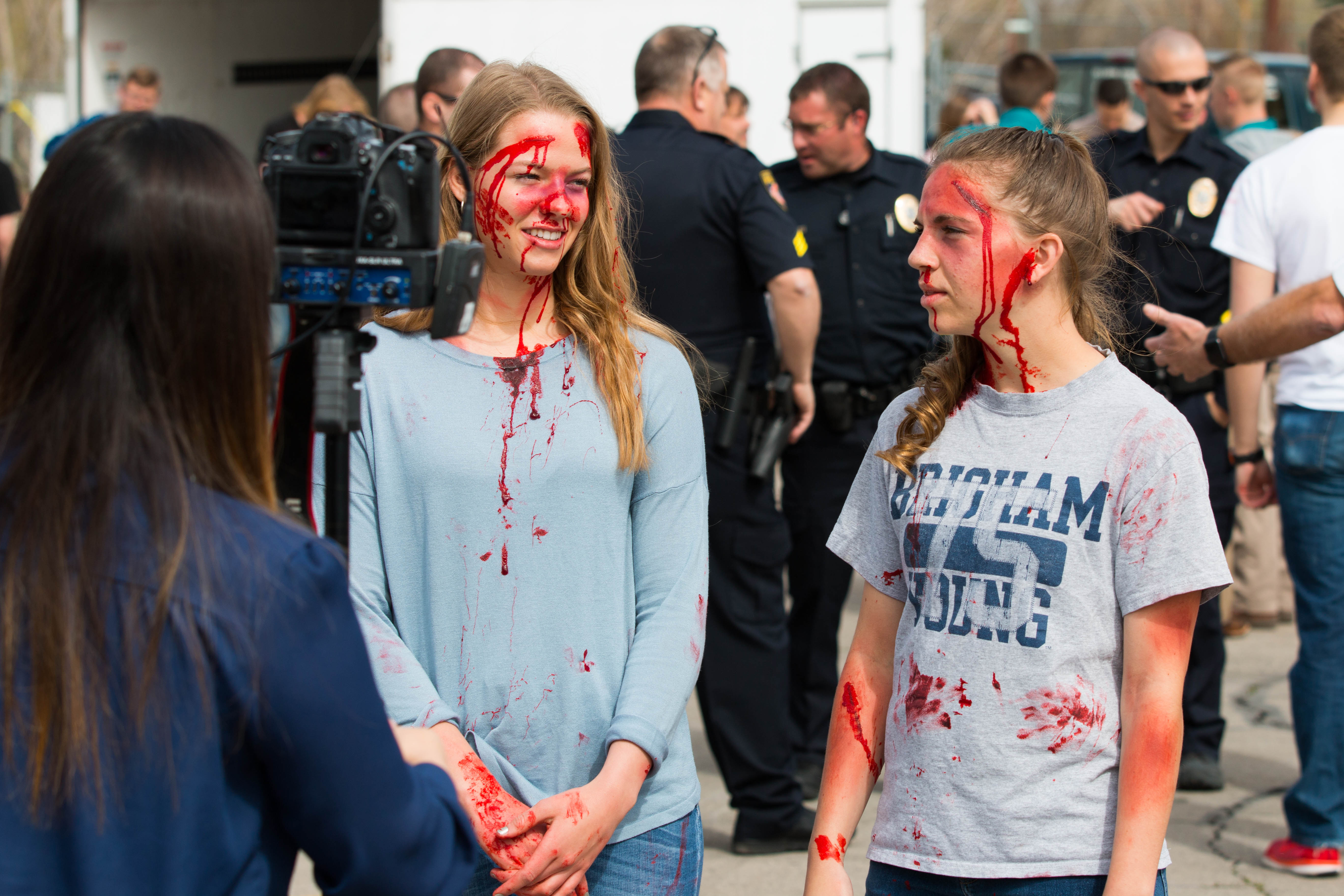 Two students with moulage talk to the media. UHP, Springville PD, SPringville Fire and Rescue, Utah County Sheriff's Office and Lifeflight teamed up to conduct a mock crash at Springville High School on April 10th.