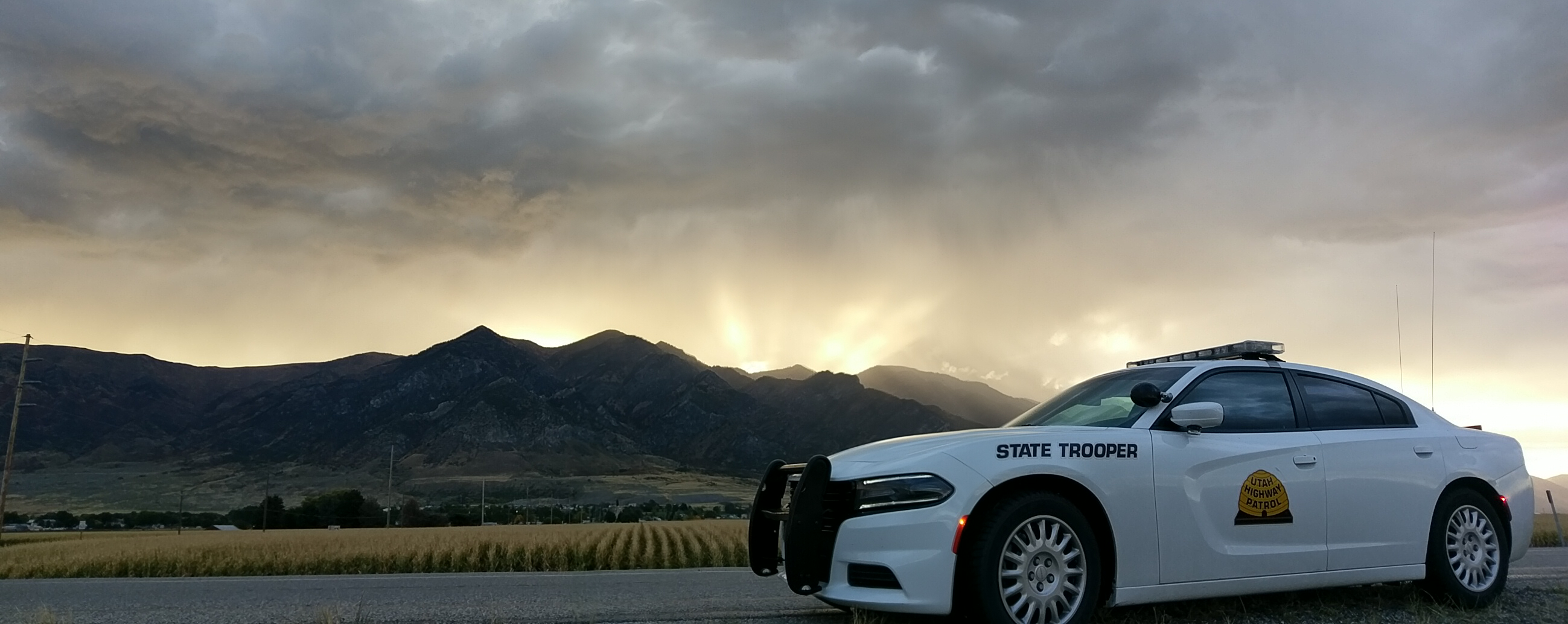 A UHP Charger is juxtaposed with sunset behind the mountains in section 1.