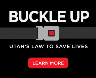 "Button with ""Buckle Up - click to learn more about Utah's seat belt law"""