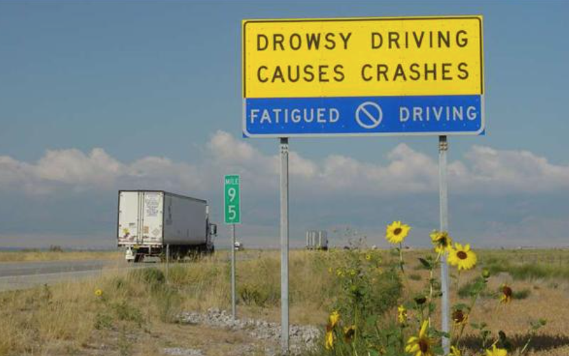 drowsy drivers cause crashes freeway sign