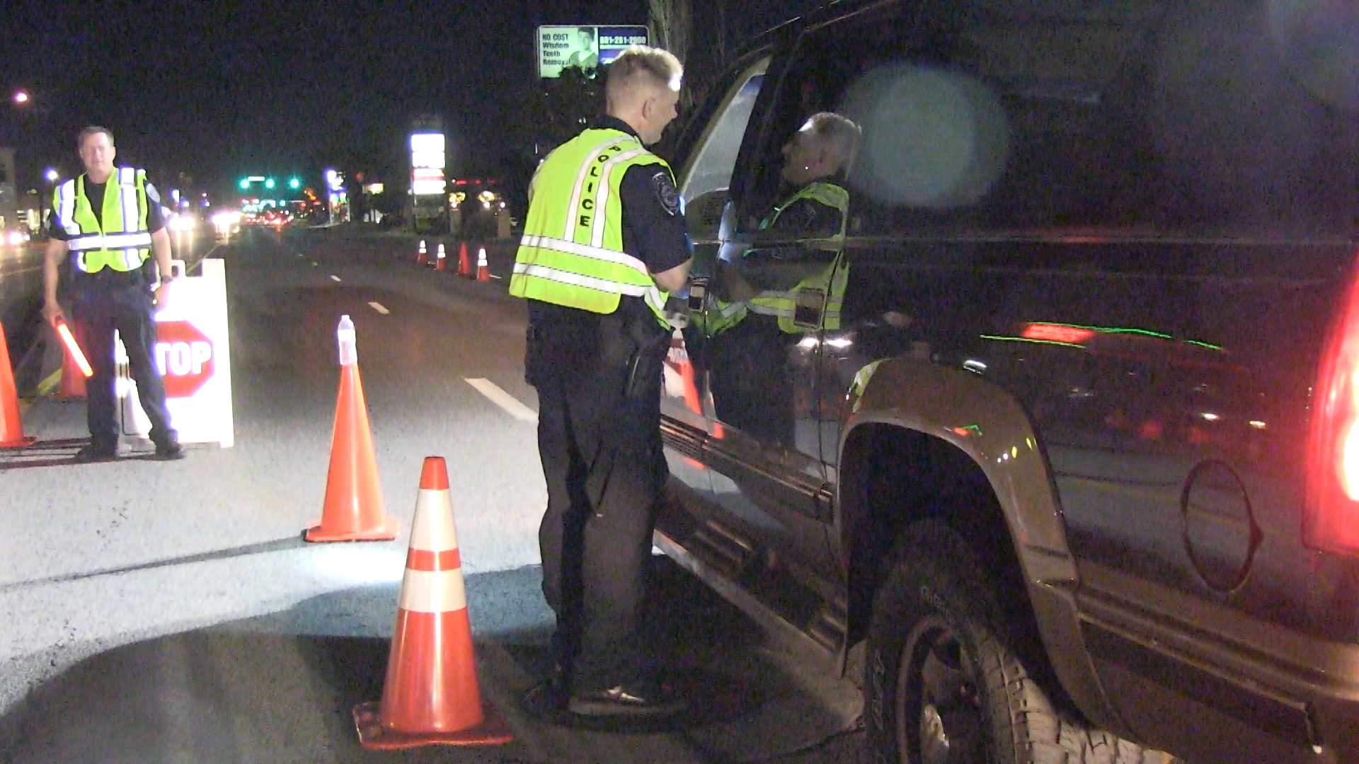 Officer talking to driver during a DUI checkpoint
