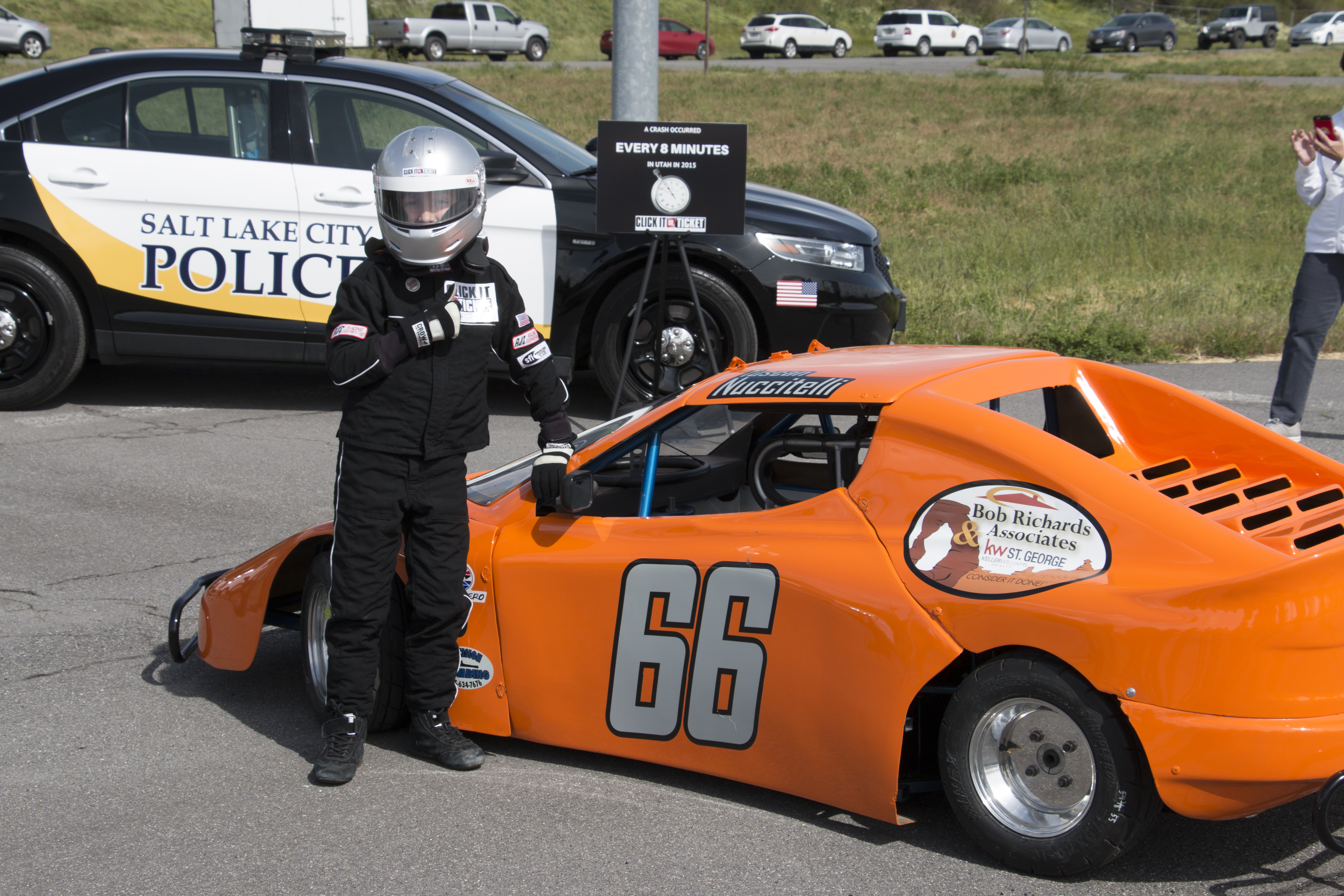 Tuscan Nuccitelli gives a thumbs up standing by his race car.