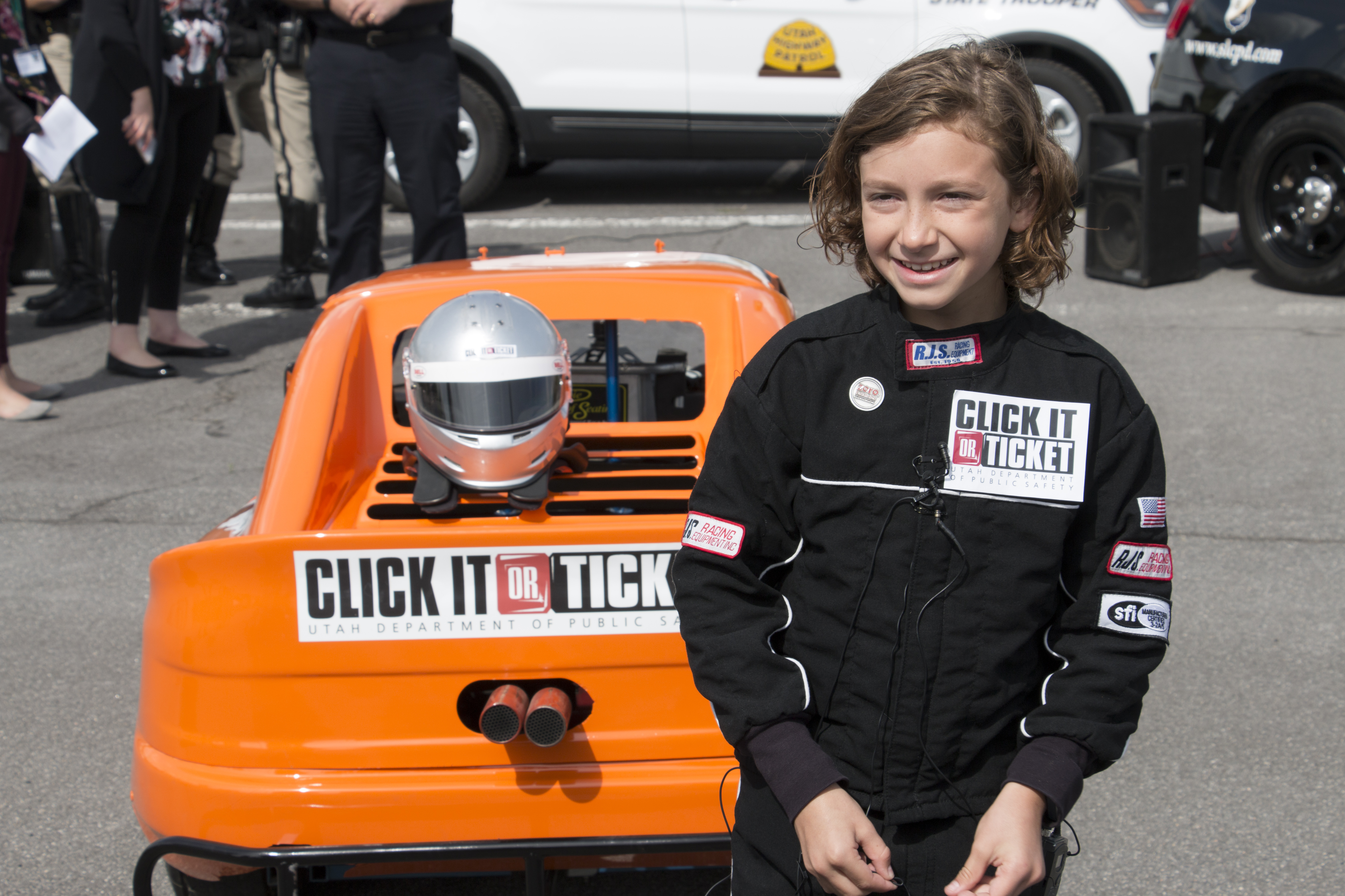 Nine year old Tuscan Nuccitelli stands by his race car.