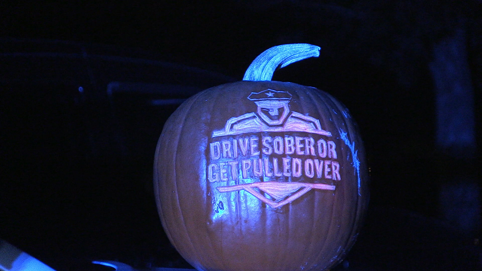 Pumpkin carved with the Drive Sober or Get Pulled Over logo.