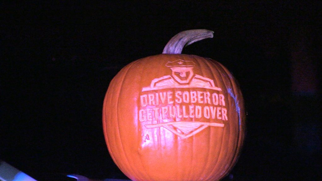 Pumpkin is carved with the Drive Sober or Get Pulled Over Logo