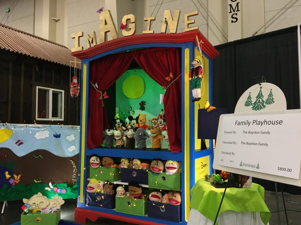 Puppet stage featuring three dozen puppets and adorned with the word Imagine and Disney quotes