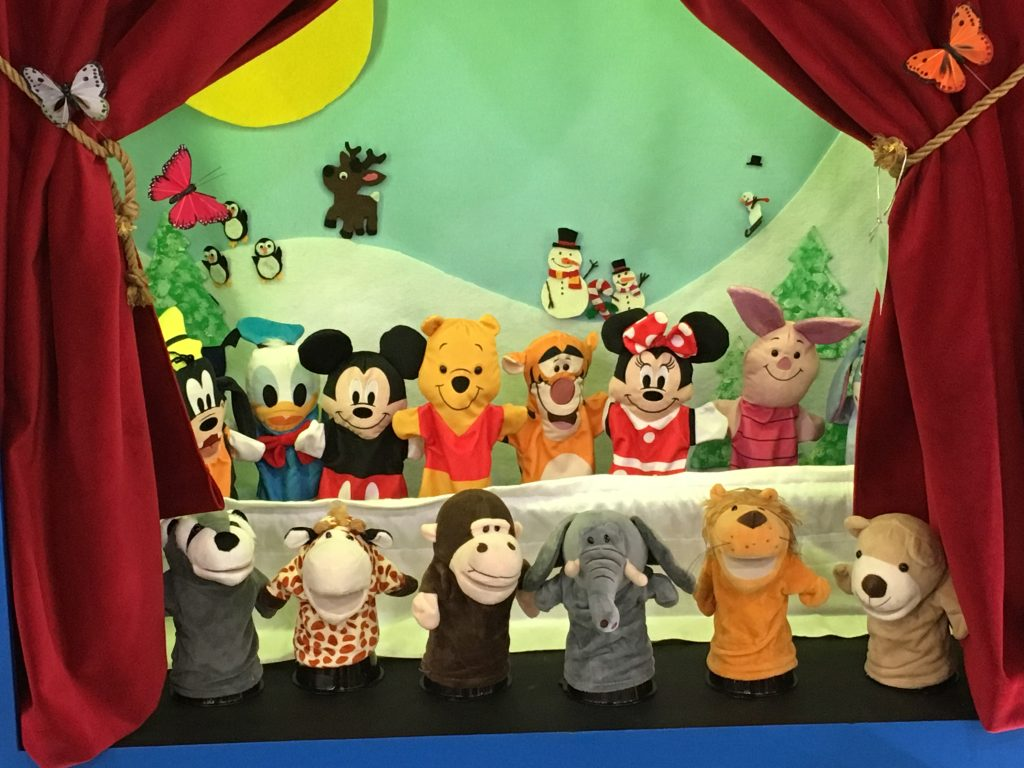 hand puppets on a puppet stage