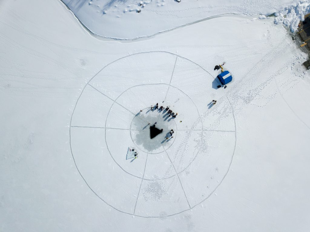 Aerial photo of the ice diving training at Deer Creek Reservoir.