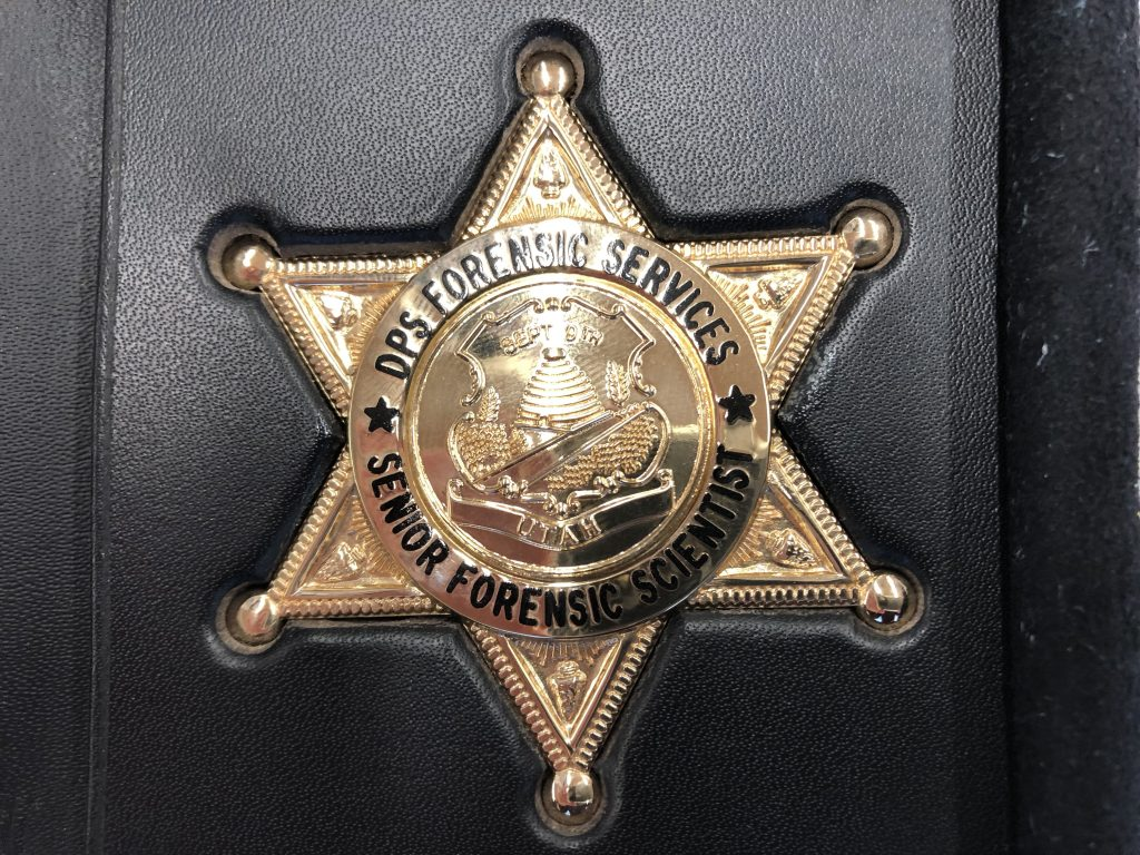 DPS Forensic Services employees are issued badges.