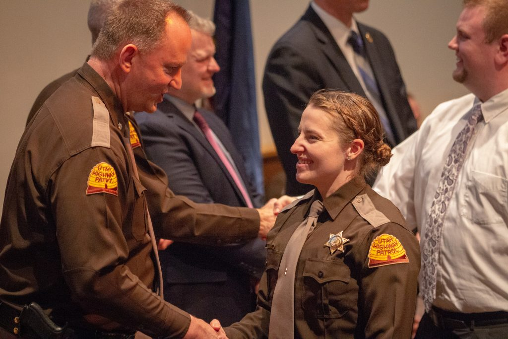 Lt. Colonel Zesiger congratulates new Trooper Svedin