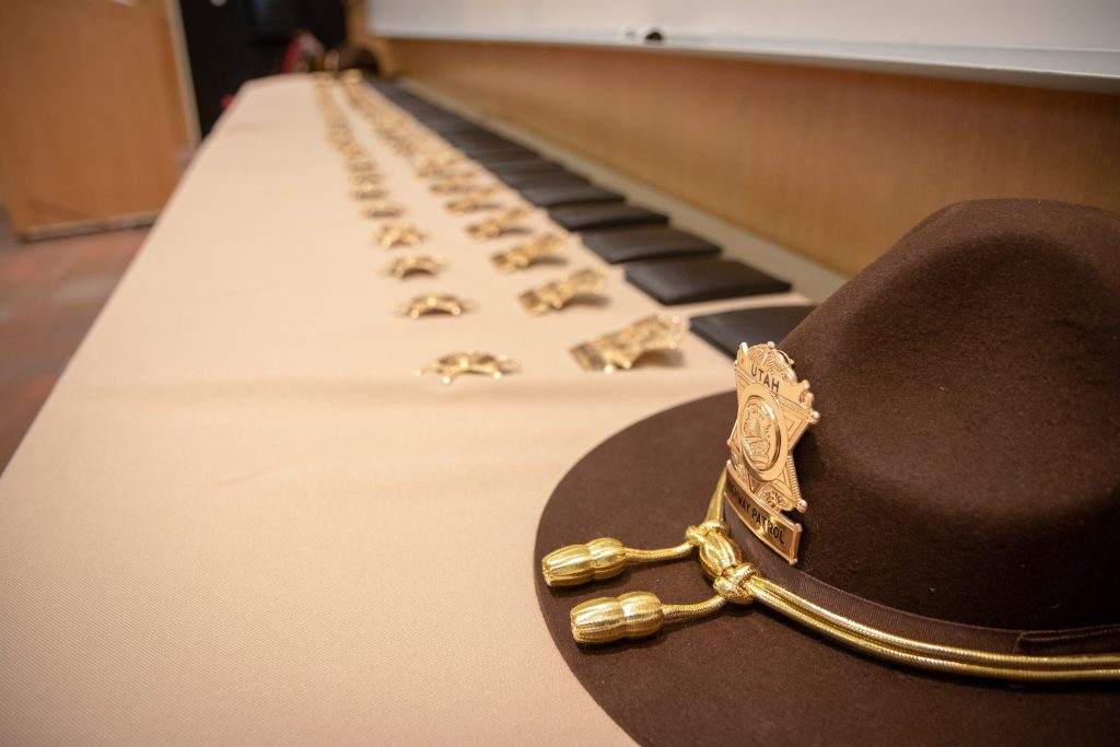 The badges for the new UHP troopers are displayed on a table.