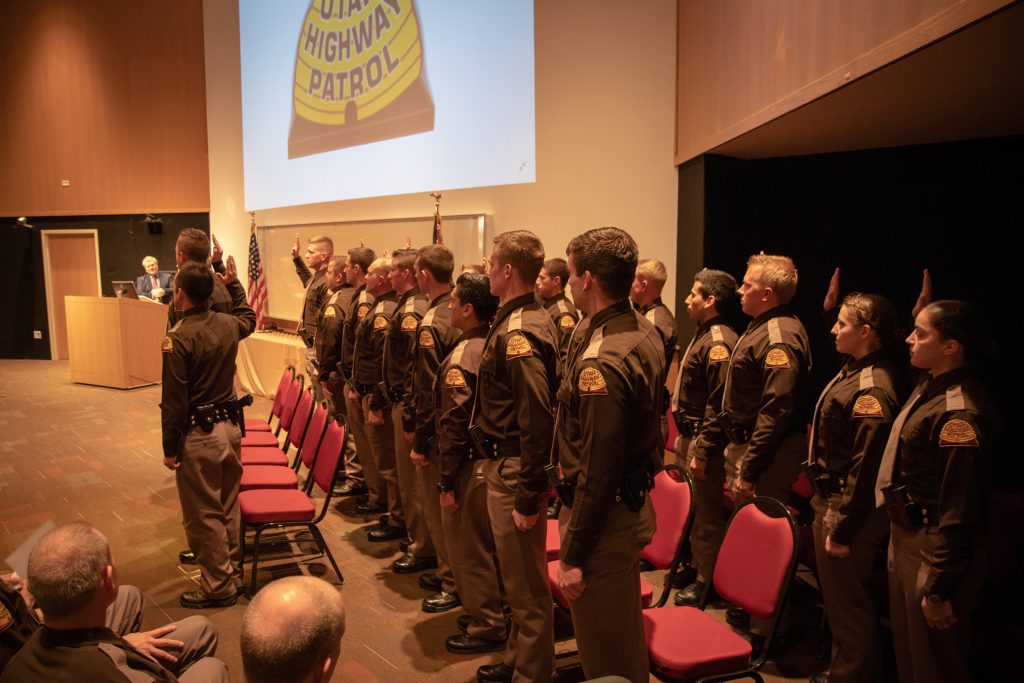 The new UHP troopers take the oath of office which is being administered by Utah Supreme Court Justice John A. Pearce.