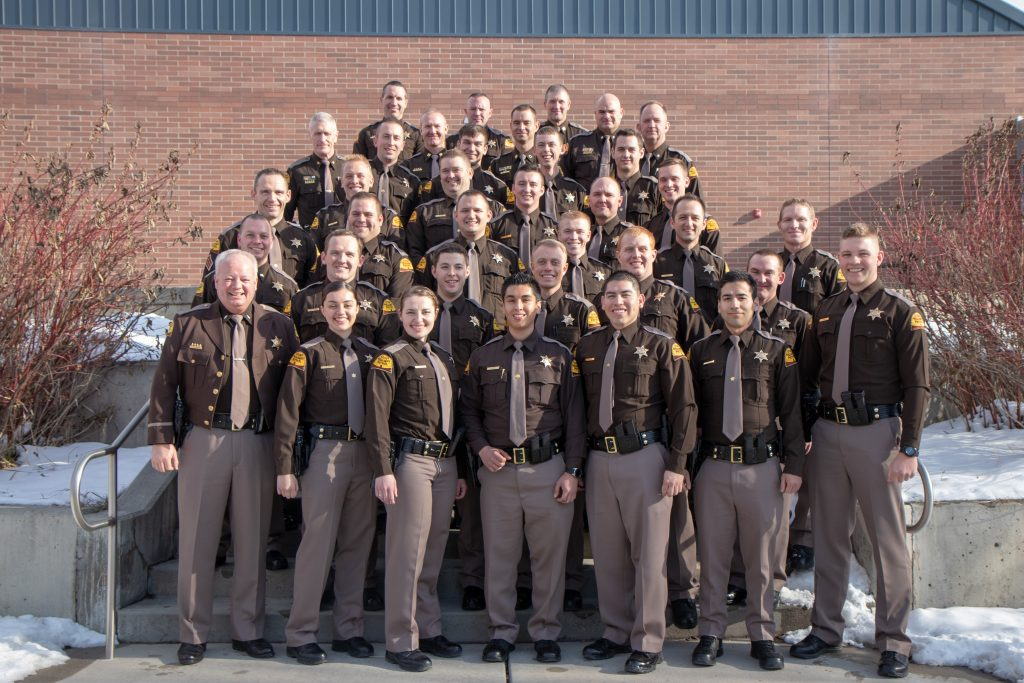 The members of UHP One and administration pose for a photo.