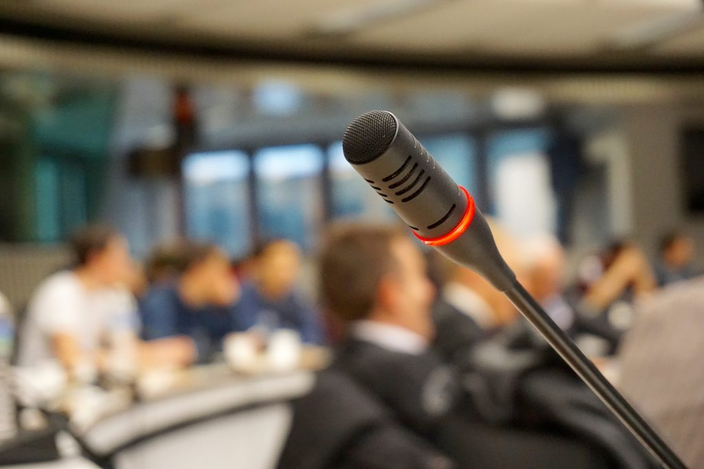 image of a microphone ready to receive public comment.