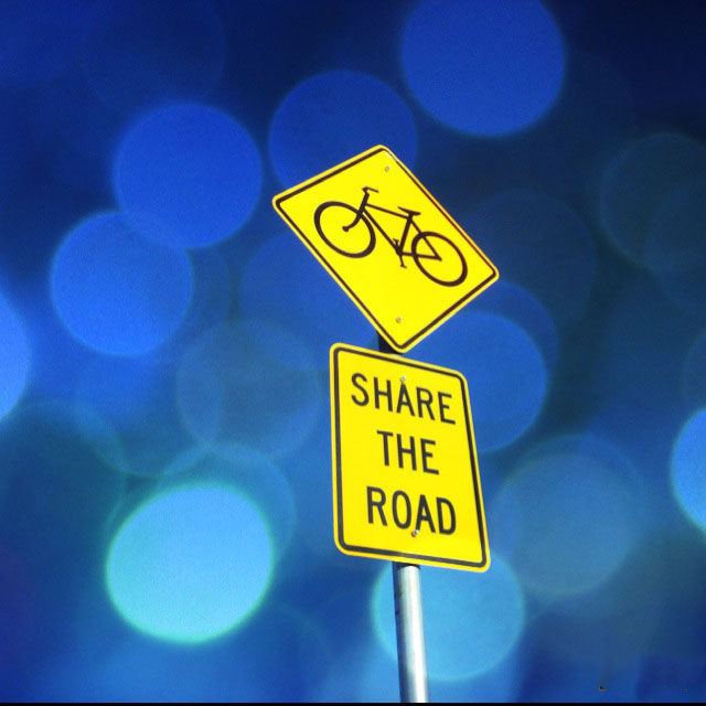 Share the road with bicycles sign.