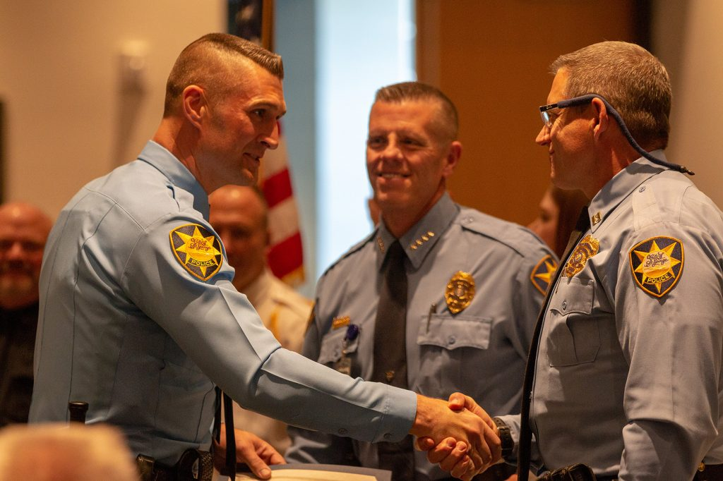 New St. George PD officer shakes the chief's hand