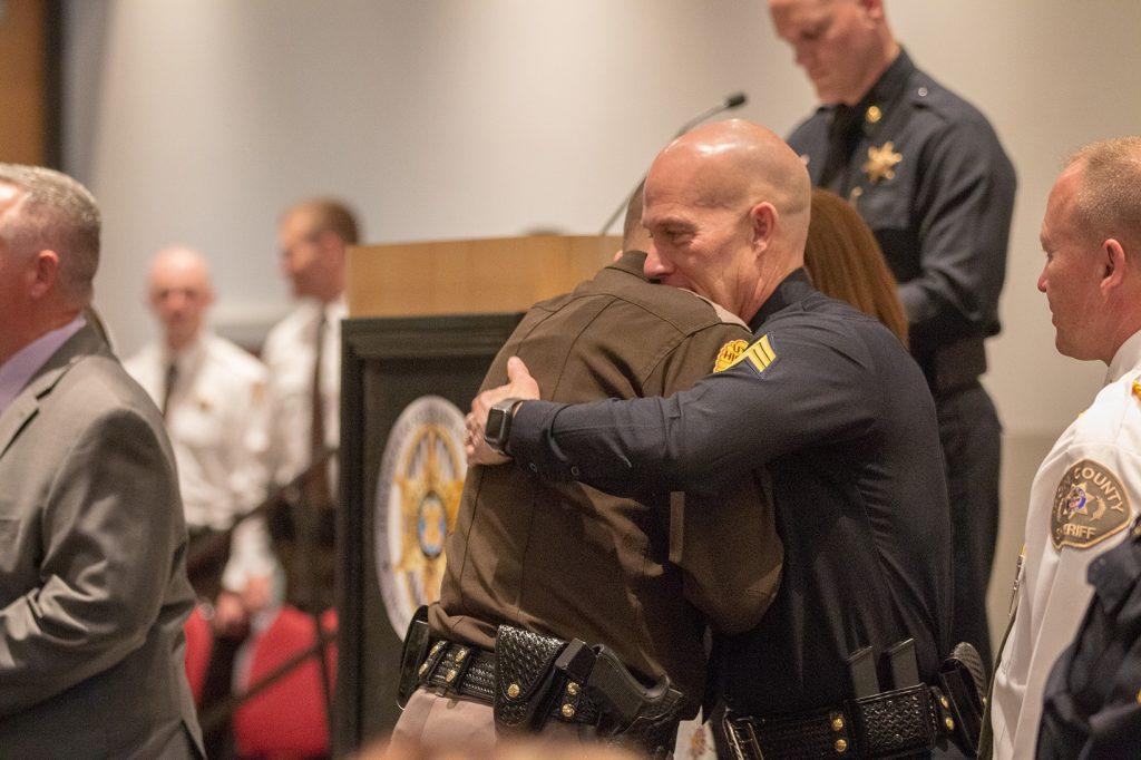 Sgt. Lauritzen embraces a graduating UHP trooper