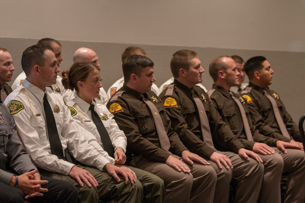 Utah County SO and UHP troopers listen to speakers at the graduation