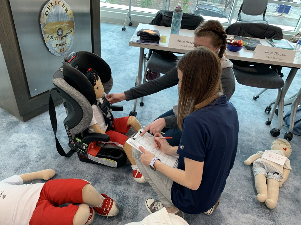 Instructor reviews car seat choice and fit with a student.